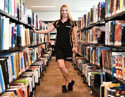 ACPE student in the campus library